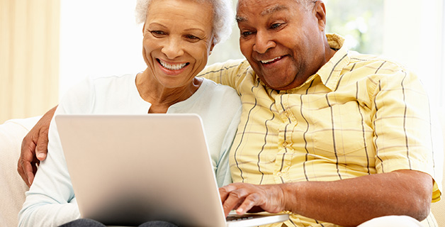 Senior couple filling out easy, online rental application